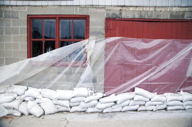 Sandbags and glass sheet on building wall