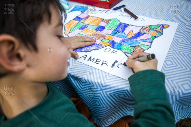 Mixed race boy coloring United States map