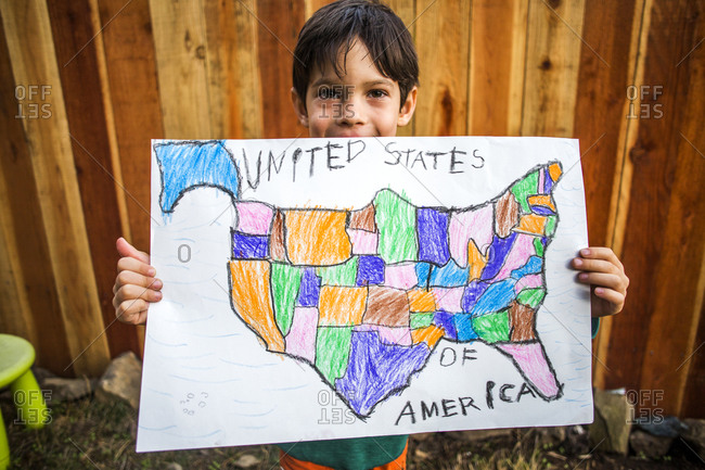 Mixed race boy holding United States map
