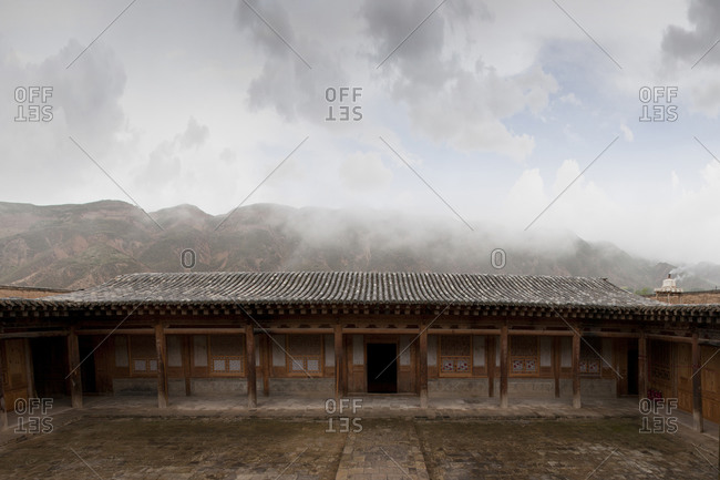 Remote monastery and cloudy sky, Qinghai, Tibet, China