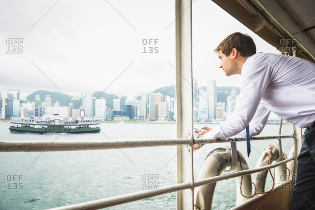 Caucasian businessman admiring view on ferry