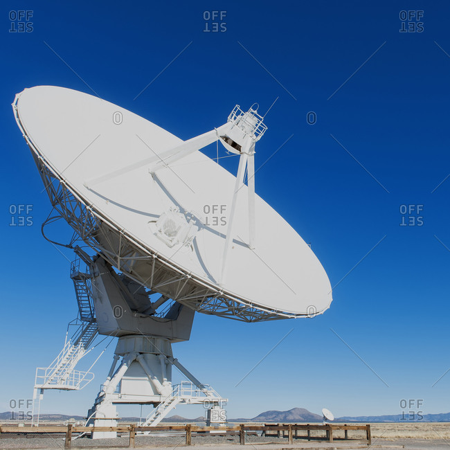 Satellite dish under blue sky