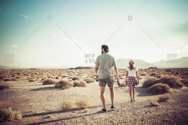Hispanic couple walking in desert