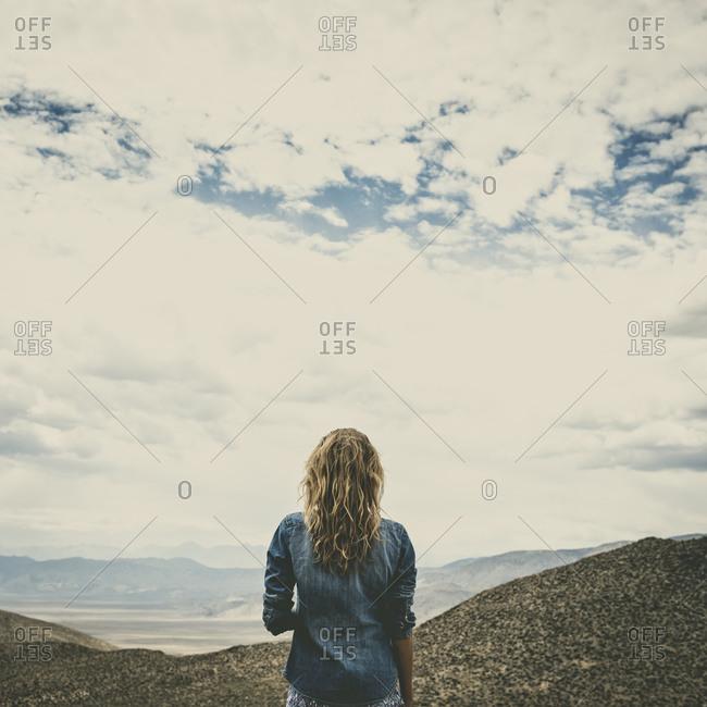 Hispanic woman admiring remote landscape