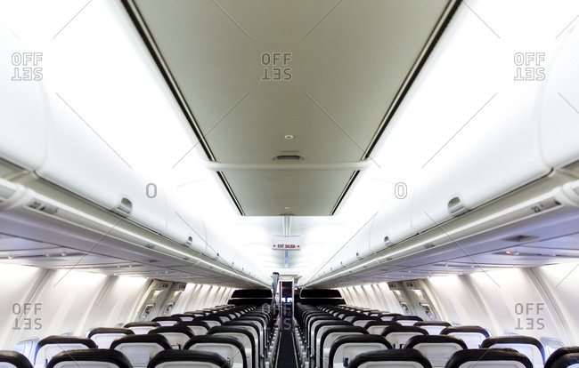 Empty chairs and compartments in airplane