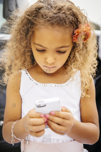 Mixed race girl using cell phone