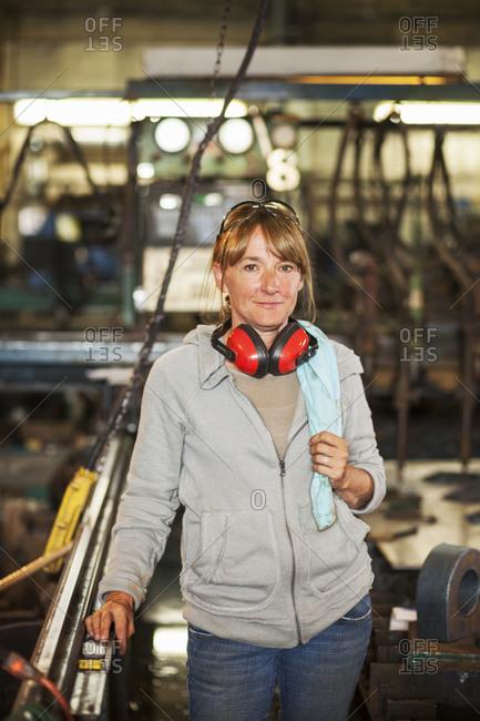 Caucasian worker smiling in factory