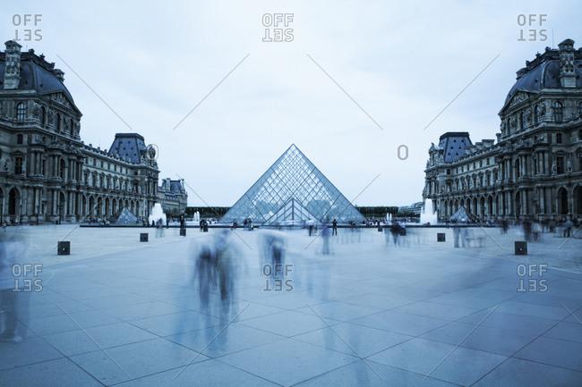 Paris, France - June 12, 2011: Blurred view of people outside Louvre museum, Paris, Ile-de-France, France