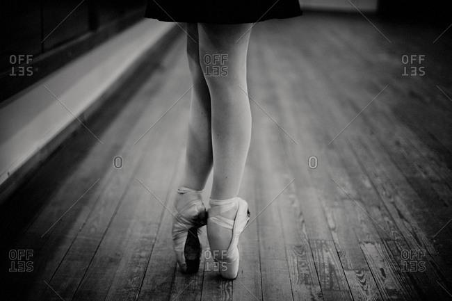 Caucasian ballerina standing on pointe