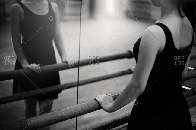 Caucasian ballerina standing at barre