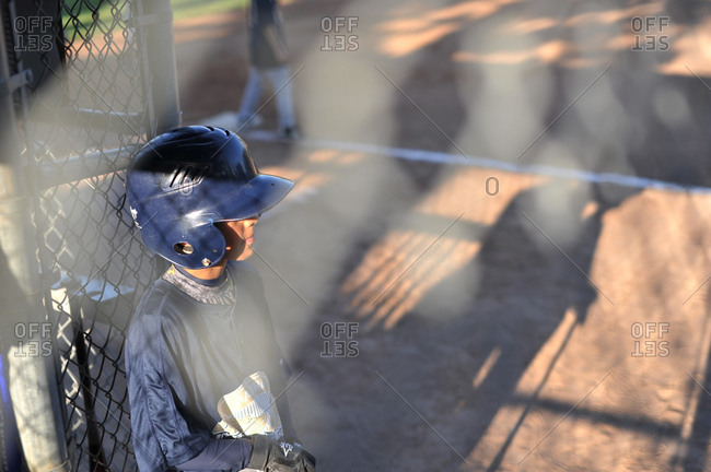 Boy in baseball helmet at field