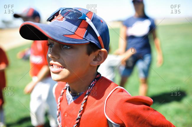 Boy watching baseball team