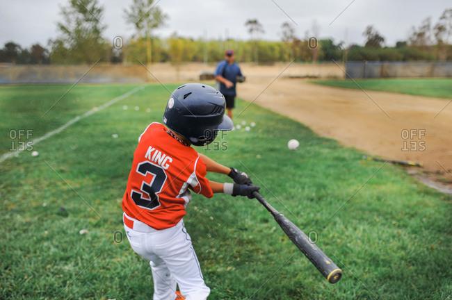 Boy taking swing at baseball