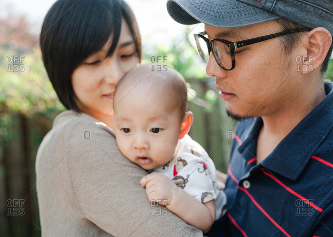 Close up of couple with baby boy