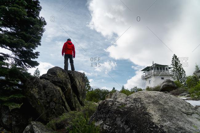 Man in wilderness near lodge