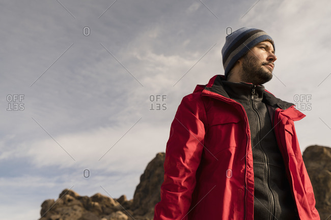 Man in jacket in rocky wilderness