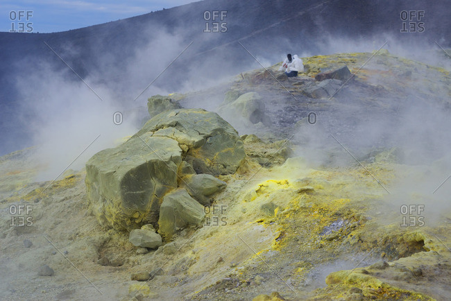 Geologists taking minerals samples on Gran Cratere (The Great Crater), Vulcano Island, Aeolian Islands, Sicily, Italy