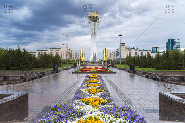 September 7, 2014: Central Asia, Kazakhstan, Astana, Nurzhol BulvarCentral Boulevard and Bayterek Tower illuminated at night