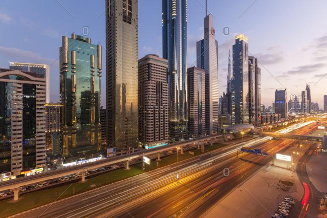 December 3, 2014: United Arab Emirates, Dubai, Sheikh Zayed Rd, traffic and new high rise buildings along Dubai's main road