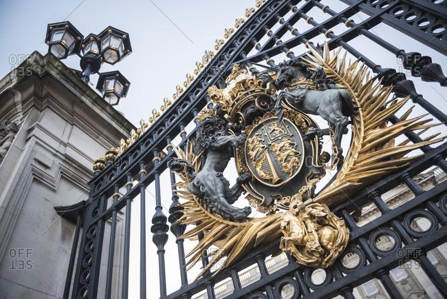 Royal Coat of Arms on the gates at Buckingham Palace, London, England