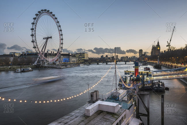December 8, 2015: Tattershall Castle and The London Eye at night seen from Embankment, London, England