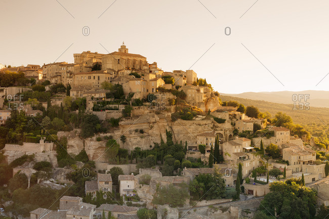 Hilltop village of Gordes with castle and church at sunrise, Provence, Provence-Alpes-Cote d'Azur, Southern France, France