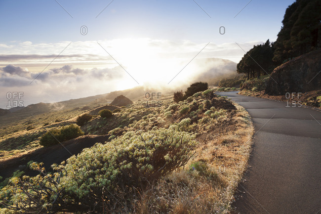 Road at the south coast at sunset, near Orchilla Volcano, UNESCO biosphere reserve, El Hierro, Canary Islands, Spain