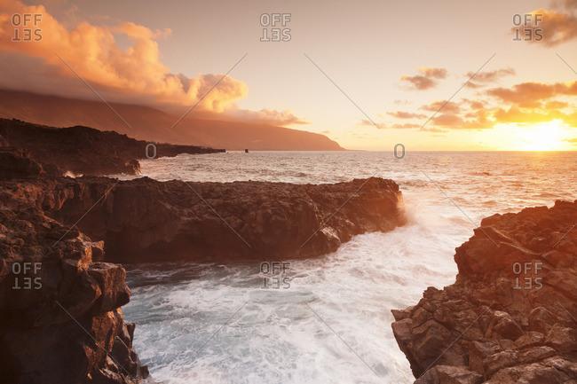 Lava coast of Las Puntas at sunset, El Golfo, biosphere reserve, El Hierro, Canary Islands, Spain
