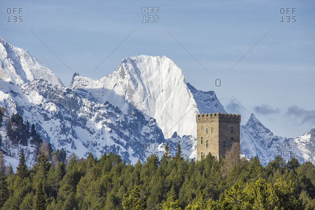 The Belvedere Tower frames the snowy peaks and Peak Badile on a spring day Maloja Pass Canton of Graubunden Switzerland Europe