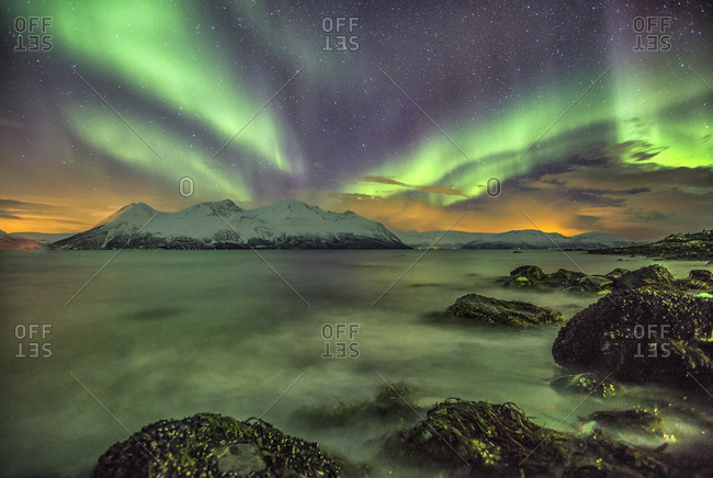 Northern Lights on the icy sea of Svensby Lyngen Alps Tromso Lapland Norway Europe
