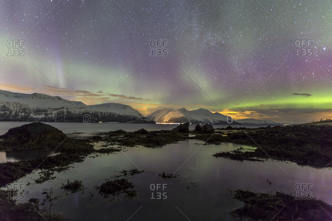 Northern Lights on the icy landscape of Svensby Lyngen Alps Tromso Lapland Norway Europe