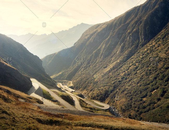 Cyclist on a winding mountain pass