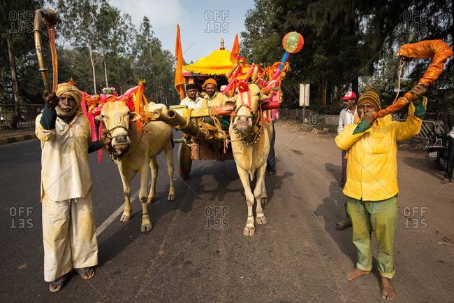 Hubli, India - January 5, 2015: Indian men with a colorful cart during a parade