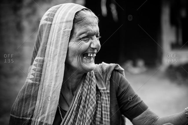Karnataka, India - January 6, 2015: Portrait of an elderly smiling Indian woman