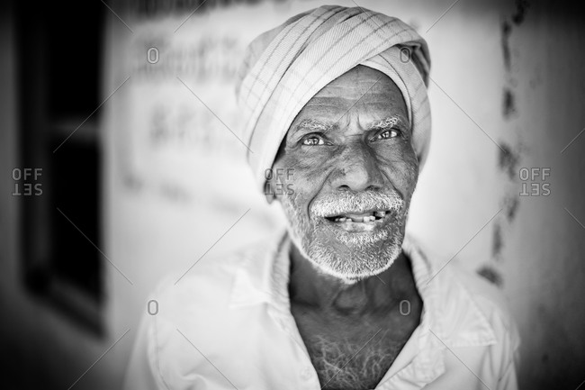 Hyderabad, India - January 15, 2015: Portrait of an elderly Indian man wearing a head scarf