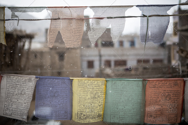 Buddhist prayer flags and snowflakes in Ladakh, India