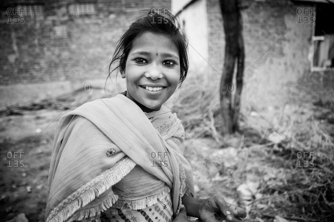 Jaipur, India - February 28, 2015: Portrait of a smiling young Indian woman