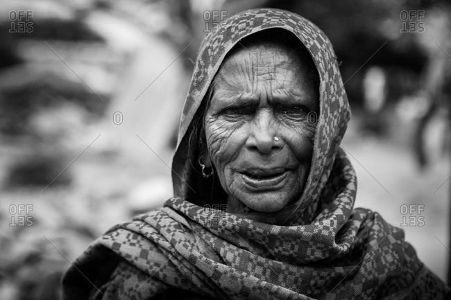 Jaipur, India - February 28, 2015: Portrait of a senior woman wearing a head scarf in India