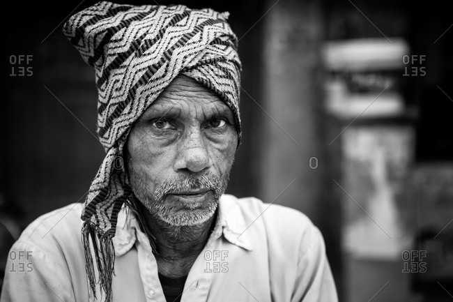 Jaipur, India - February 28, 2015: Senior Indian man with his head wrapped in a scarf