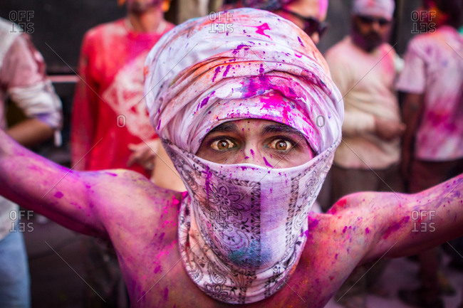 Pushkar, India - March 6, 2015: Man covered in bright pink dye during Holi Festival in Pushkar, India