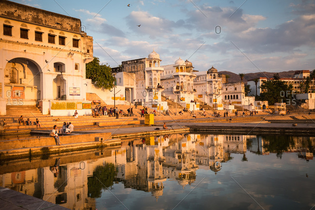Pushkar, India - March 5, 2015: People hanging out at the waterfront near Pushkar Lake, India