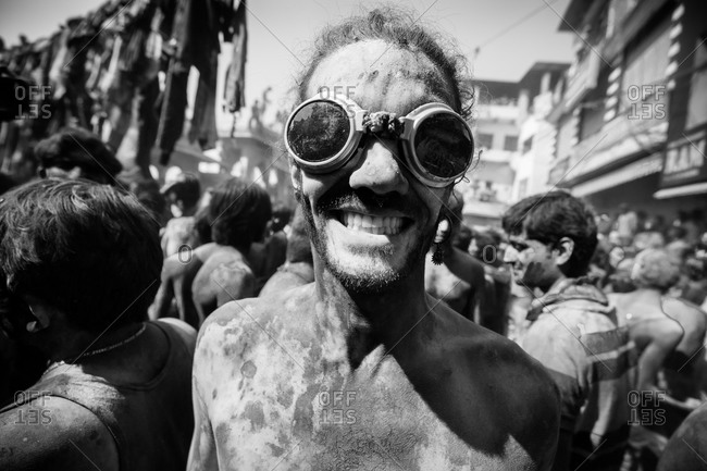 Pushkar, India - March 6, 2015: Young man in goggles in the crowd during Holi Festival in Pushkar, India