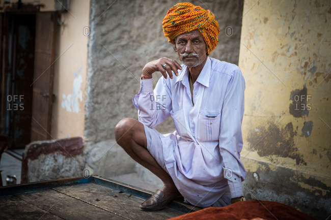 Jaipur, India - March 10, 2015: Senior man in loafers and a turban in Jodhpur, India