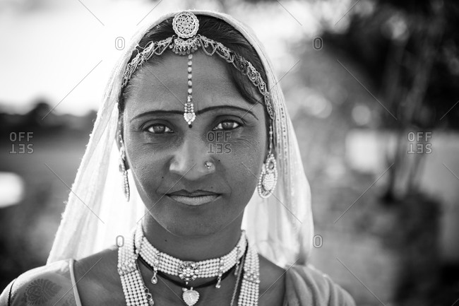 Rajasthan, India - March 16, 2015: Portrait of a young Indian woman in a veil and jewelry