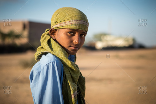 Rajasthan, India - March 16, 2015: Portrait of an Indian boy wearing a head scarf