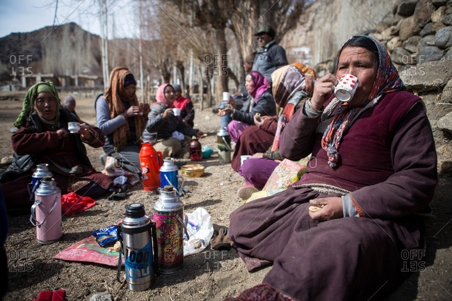 Leh Ladakh, India - February 11, 2015: Group of women sitting together outside in the Himalayan region of Leh Ladakh, India
