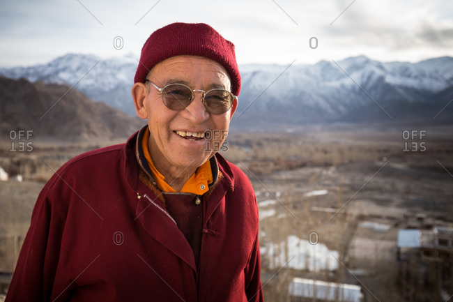 Leh Ladakh, India - February 11, 2015: Portrait of a smiling man standing outside in the Himalayan region of Leh Ladakh, India