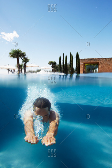 Man diving into a pool, Provence, France