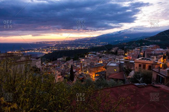 View over Taormina to Mount Etna in the evening, Taormina, Messina, Sicily, Italy