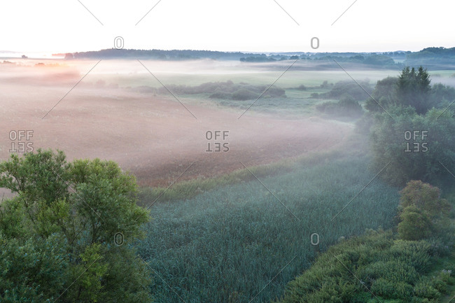 Scenery with fields in morning fog in the Schorfheide-Chorin Biosphere Reserve